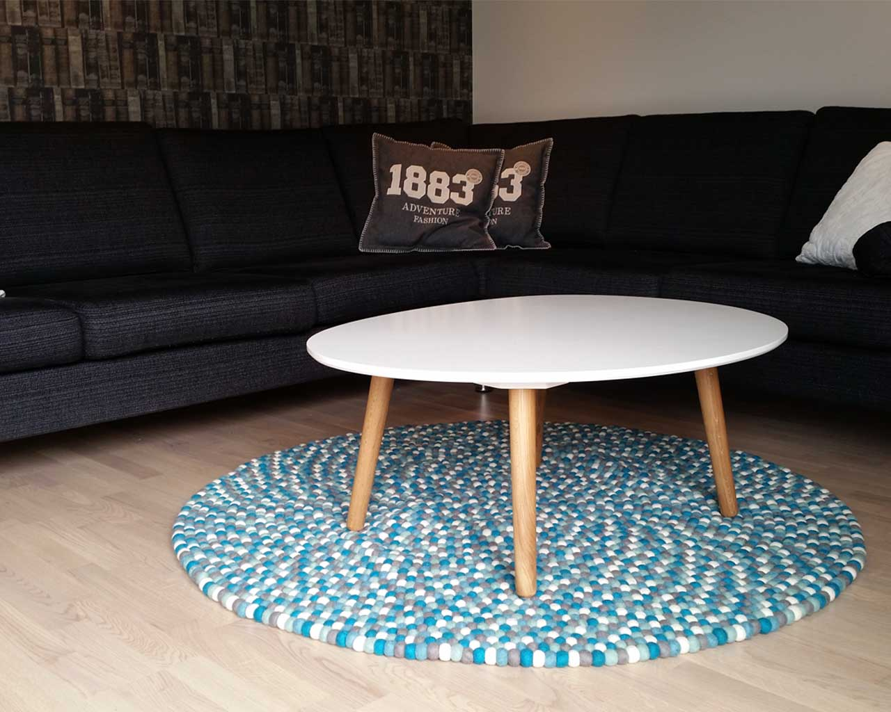 black sofa and white round table nepal traditional room area rugs